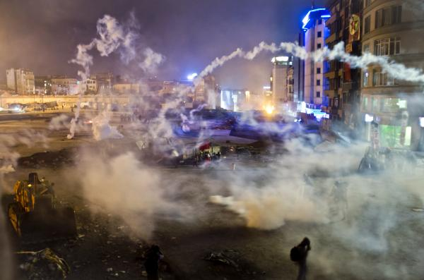 Taksim Square is flooded by tear gas as clashes between protesters and riot police continue into the night in Istanbul. After hundreds of police in riot gear forced through barricades to take control of the square early Tuesday, protesters returned.