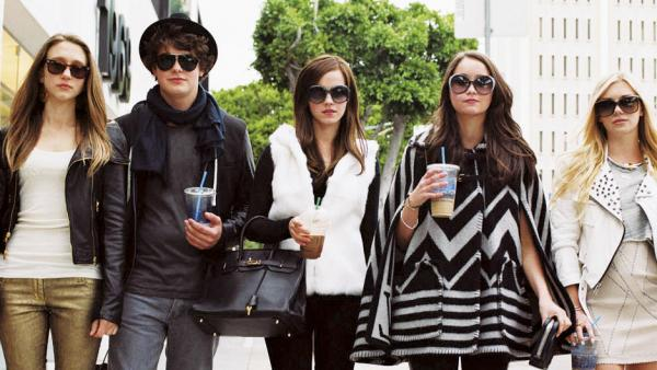 "Taissa Farmiga (left) and Israel Broussard are key players in the five-person posse (otherwise known as the ""Hollywood Hills Burglar Bunch"") targeting celebrity homes in <em>The Bling Ring</em>, stealing clothes, jewelry and cash from the likes of Lindsay Lohan."