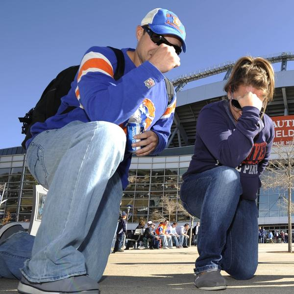 "Fans ""Tebow"" in front of Sports Authority Field at Mile High Stadium in Denver before the start of a game between the Denver Broncos and Detroit Lions on Oct. 30, 2011."