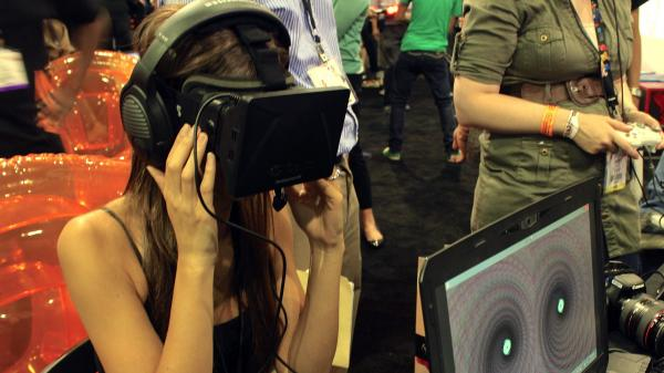 Actor Tamara Bruketta experiences the Oculus VR version of <em>SoundSelf</em> at the E3 gaming conference in Los Angeles.