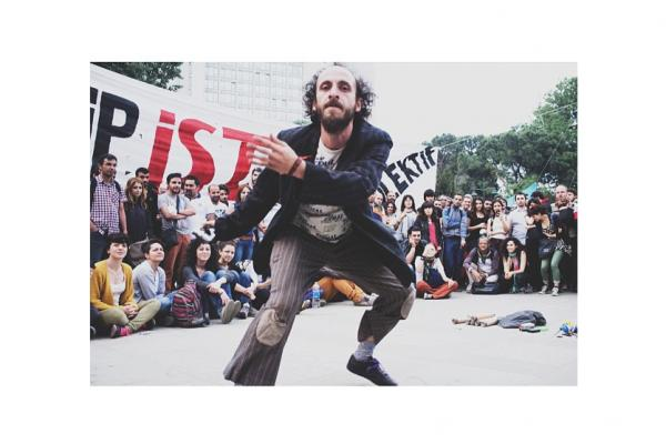 "In Gezi Park, a man takes part in ""You're Not a Fish After All,"" a Turkish play dedicated to an Armenian journalist who was murdered in 2007. It's one of many performances including yoga and piano recitals that have occurred since the park occupation began. (Posted June 4)"