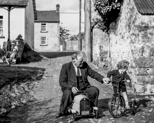 Bobbie Hanvey as a child with his father, Johnny Hanvey. Johnny was a lumberjack who used to go everywhere with a camera. He gave one to his son, and set him off on a career as a photojournalist and documentarian.