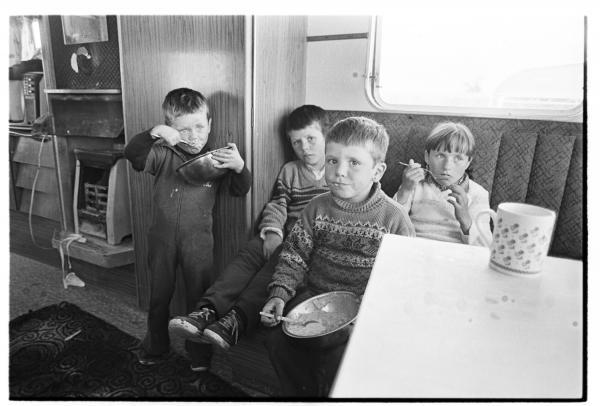 Children eat in a caravan, mid-1980s.