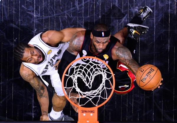 LeBron James of the Miami Heat goes up for a shot against Kawhi Leonard of the San Antonio Spurs during Game 4 of the NBA Finals at the AT&T Center in San Antonio on Thursday.