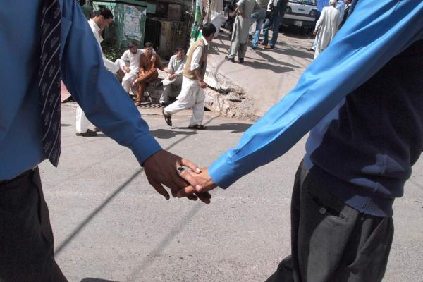 Brothers head home after school in Murree. The boys hold hands, expressing friendship and bonding.