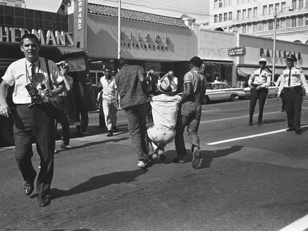 A protestor is carried away from a demonstration in Jacksonville 50 years ago.