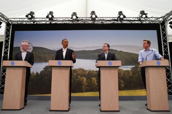 The G-8 leaders speaking at this news conference in Northern Ireland all lost their ties, but British Prime Minister David Cameron went a step further by ditching his jacket and rolling up his sleeves.