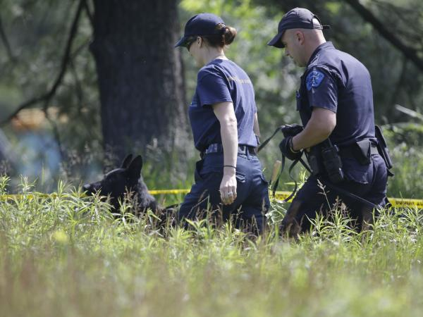 Law enforcement officials search an area in Oakland Township, Mich., on Tuesday for the remains of Jimmy Hoffa. The former Teamsters president was last seen at a Detroit-area restaurant in 1975.