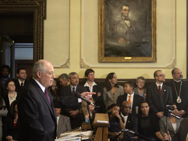 Illinois Gov. Pat Quinn speaks with reporters at the Capitol in 2011 after signing legislation abolishing the death penalty in the state.