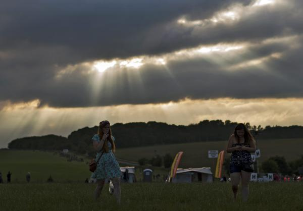Revelers arrive to attend the annual celebration of the summer solstice at Stonehenge, southwest of London.