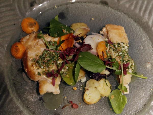 Diners' knowledge of frequently mislabeled fish was tested with an escabeche-style grouper, left, paired with an escabeche-style weakfish, right, and potatoes between them.
