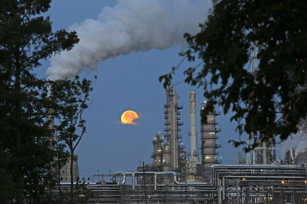 The supermoon behind a refinery in Norco, La., June 23