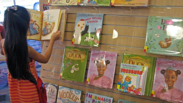 At a San Jose, Calif. library, a young reader browses a shelf of books featuring a variety of main characters: ducks, hens, white kids, black kids. Libraries help drive demand for children's books with nonwhite characters, but book publishers say there aren't enough libraries to make those books best-sellers.