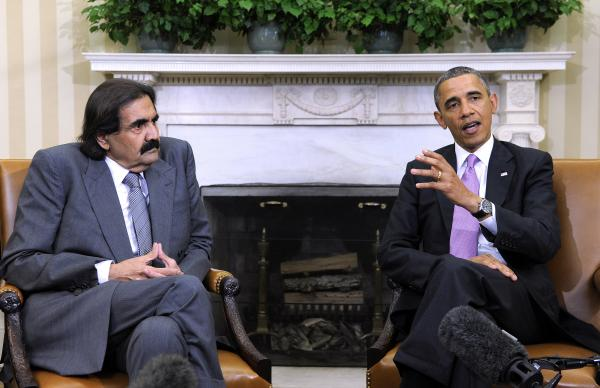 The emir of Qatar, Sheik Hamad bin Khalifa al-Thani, 61, abdicated on Tuesday in favor of his 33-year-old son. Sheik Hamad is shown here during an Oval Office meeting with President Obama in April.
