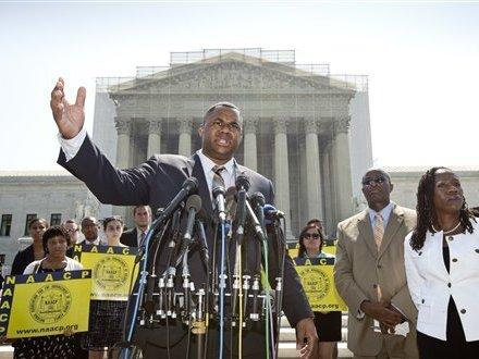 Ryan P. Haygood, director of the NAACP Legal Defense Fund, talks outside the Supreme Court on Tuesday about the court's opinion in <em>Shelby County v. Holder.</em>