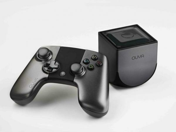 The Ouya game console and controller. Games are sold through something like an app store, allowing customers to sample them before buying.