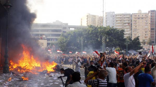 Opponents of Egypt's President Mohammed Morsi burn the contents of an office of the Freedom and Justice Party, an arm of the Muslim Brotherhood, in Alexandria Friday. Two people were reportedly killed in clashes in the city.