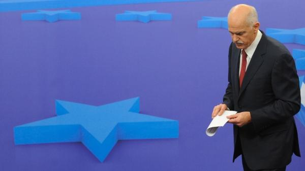<p>Greek Prime Minister George Papandreou leaves a news conference after a meeting with European Council President Herman Van Rompuy on Oct. 13 at EU headquarters in Brussels. EU leaders were surprised and angered Tuesday when Papandreou said he would place a debt restructuring proposal before Greek voters.</p>