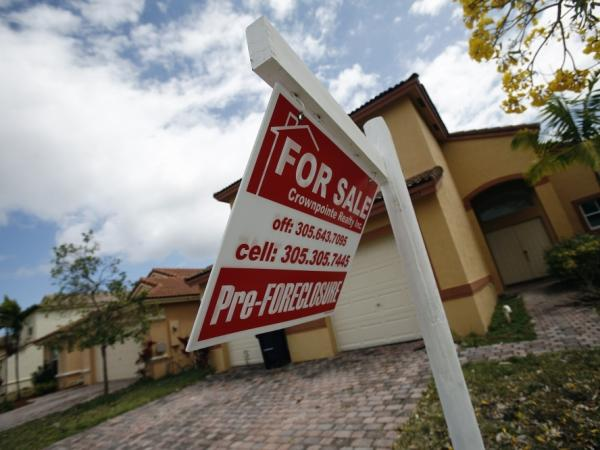 A for-sale sign hangs in front of a Homestead, Fla., home. In 2009, Florida lawyer Tom Ice deposed a bank employee who admitted to signing hundreds of mortgage documents in a day without reading them.