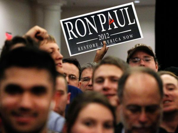 Supporters attend a party for Ron Paul on Feb. 28 in Springfield, Va. Paul and Mitt Romney are the only two candidates on the ballot for Virginia's Tuesday contest.