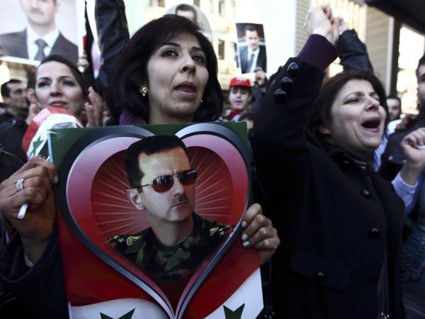 Syrians and Turks show their support for Syria's Assad in Antakya on Feb. 19. Hatay province, where Antakya is located, was once part of Syria.