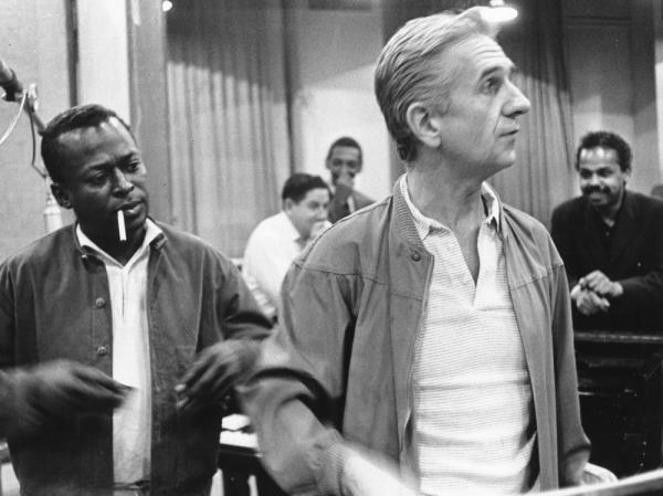 Gil Evans in the studio with Miles Davis, circa 1970.