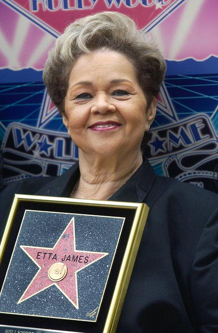 Singer Etta James displays her star during a ceremony honoring her on the Hollywood Walk of Fame April 18, 2003 in Hollywood, California.