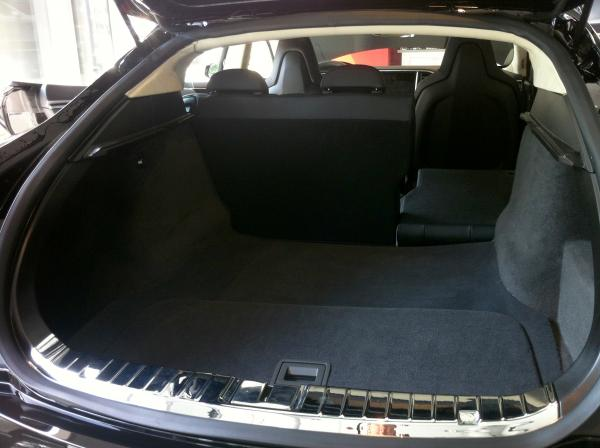 The rear trunk of the Model S sedan includes a removable panel (in foreground) that allows access to more storage.