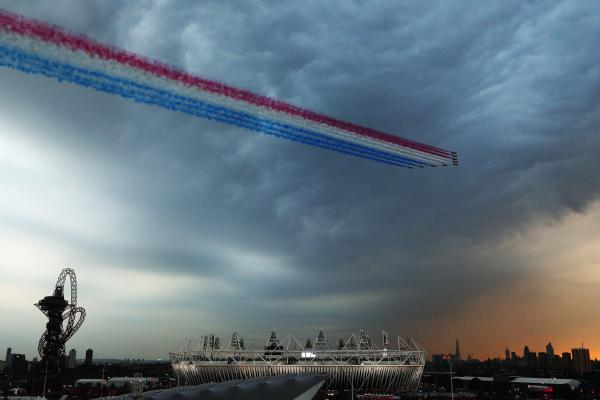 The Red Arrows, the Royal Air Force's aerobatic team, fly over the Olympic Park during the ceremony.