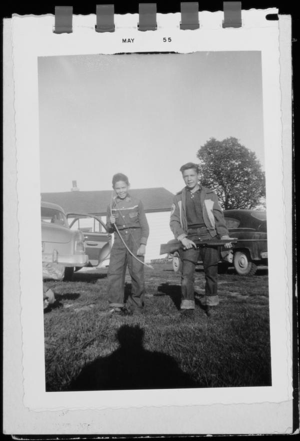 Neil Young's brother, Bob, holding a rifle, and Neil with a bow: Omemee, Ontario, 1955.