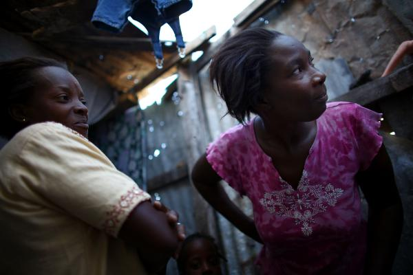 Bibeta Louissaint (left) and Beatrice Rochelain are neighbors in the Fort National neighborhood in Port-au-Prince. Many people who received cash and subsidies to move out of the camps have returned to the area.