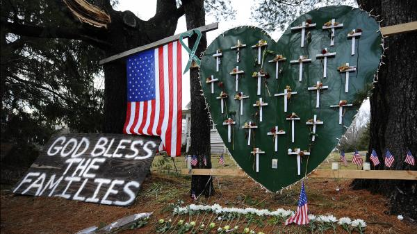 A memorial stands in a yard near the Sandy Hook Elementary School a month after the mass shooting that left 27 dead, including 20 children, in Newtown, Conn.