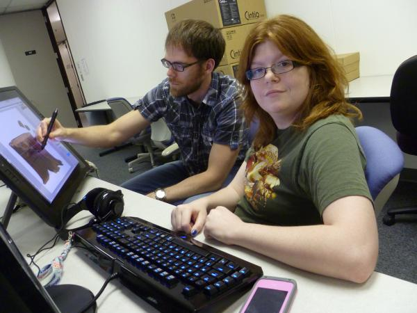 Amelia Schabel, 23, works with art director Andrew LaBounty at the nonPareil Institute in Plano, Texas.