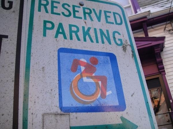 In the beginning of their project, Sara Hendren and Brian Glenney stuck their new design over existing handicapped signs around Boston.