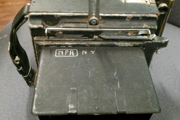 """NPR NY"" is etched into the top of this pre-1955 Crown Graphic camera."