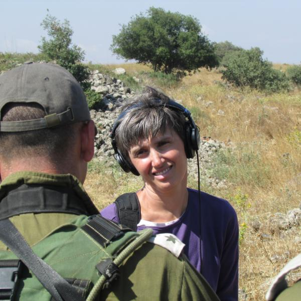 NPR International Correspondent Emily Harris interviewing a commander during an Isralie military exercise in northern Israel.