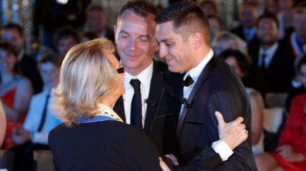 In Montpellier, France, Vincent Autin (center) and Bruno Boileau, with Mayor Helene Mandroux, are married in a civil ceremony on May 29. They were the first same-sex couple to marry in France after the government voted to legalize gay marriage.