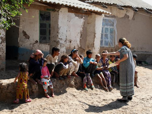 Kids from Orion Qurbonaliev's family listen to a counselor from Doctors Without Borders explain how to stop the spread of tuberculosis. The family lives near Voce, Tajikistan.