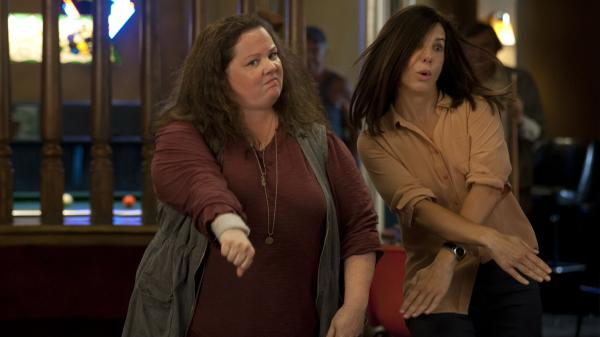 Melissa McCarthy and Sandra Bullock in <em>The Heat</em>.