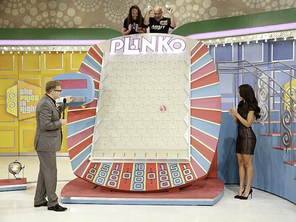 Carlos Santiago and his daughter, Jasmine, play Plinko as show host Drew Carey and model Manuela Arbelaez on a special Father's Day episode of <em>The Price Is Right</em>. (Plinko is terrible.)