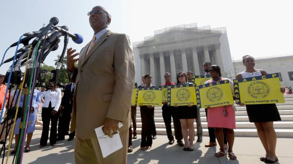 Field director Charles White of the NAACP speaks at a podium outside the U.S. Supreme Court on Tuesday. The court ruled that a key part of the Voting Rights Act is unconstitutional.