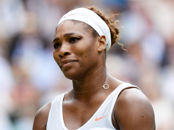 Defending champion Serena Williams lost to Sabine Lisicki of Germany 6-2 1-6 6-4 in the fourth round of the Wimbledon Championships.