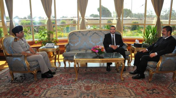 "<strong>Before The Fall:</strong> Then-Egyptian President Mohammed Morsi (right) met Monday with Prime Minister Hesham Kandil (center) and Defense Minister Gen. Abdel-Fattah al-Sisi in Cairo. Since then, the military has ousted Morsi, suspended the constitution and imposed a ""road map"" for political transition in Egypt after the president refused calls to step down."