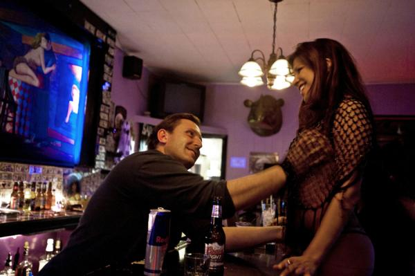"Bartender Stan Bowditch grabs Jade, who works at Big Four Ranch — a different kind of ""ranch"" — in Ely, Nev."
