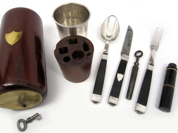"<strong>Dig In:</strong> This nonregulation Civil War mess kit features a fork, knife, spoon, corkscrew, salt and pepper shaker, and cup enclosed in a mahogany carrying case. The typical kit was much less fancy and <a href=""http://www.nwaonline.com/photos/2011/mar/06/90030/"">looked more like this</a>."