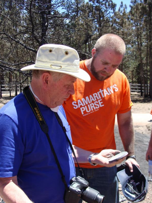 Duane Reynolds and a volunteer with Samaritan's Purse. (Megan Verlee/Colorado Public Radio)