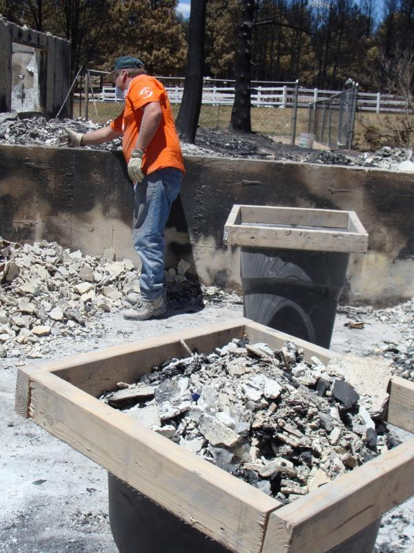 Ashes and debris in a sifting tray. (Megan Verlee/Colorado Public Radio)
