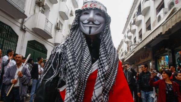 "<strong><a href=""http://menasolidaritynetwork.com/2012/05/02/tunisia-thousands-fill-streets-to-celebrate-may-day/"">Tunis, Tunisia</a>:</strong> A man wears an Anonymous mask during a May Day rally on May 1."