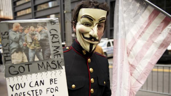 "<strong><a href=""http://www.npr.org/blogs/thetwo-way/2012/06/11/154750736/has-occupy-crashed-or-just-begun"">New York</a>:</strong> A young man with an Anonymous mask marches with Occupy Wall Street protesters on Nov. 11, 2011, at Zuccotti Park in New York."