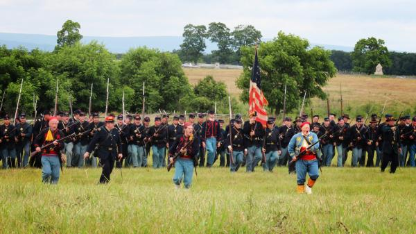 Men dressed as members of the Union infantry demonstrate battalion formations for tourists.